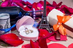 roses petals, money, bottles of wine, a box of jewels and Eiffel Tower. Royalty Free Stock Photos