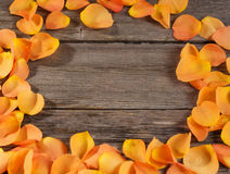 roses petals on wooden table Stock Photography