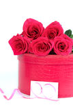 Roses with a pink box Stock Photo