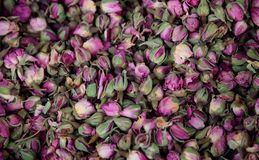 Roses pink, dried on heap. Antioxidant and healthy rosebuds for background. Close up view. Stock Photo