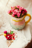 Roses in pitcher Stock Photography
