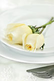Roses and Place Setting Stock Images