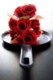 Roses on a platter. A bouquet of roses on a platter ... served chilled Royalty Free Stock Images