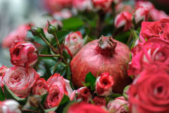 Roses and pomegranate Royalty Free Stock Image
