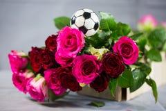 Roses pour un passioné du football Image stock