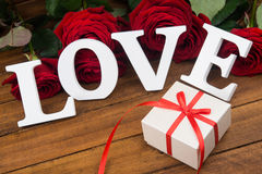 Roses and present box Stock Image