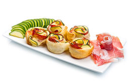 Roses puff pastry with zucchini and bacon Stock Images