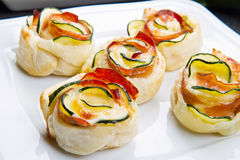 Roses puff pastry with zucchini and bacon Stock Photos