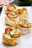 Roses puff pastry with zucchini and bacon Stock Photo
