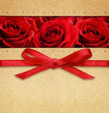 Roses and red bow on carton Royalty Free Stock Image