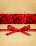 Roses and red bow on carton Stock Photo