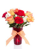 Roses in a red glass vase Royalty Free Stock Image
