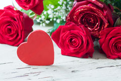 Roses and red heart Stock Photography