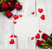 Roses and red hearts Stock Images