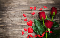 Roses and red hearts Stock Image