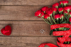 Roses, ring and a red heart, Valentines Day background, wedding Royalty Free Stock Photos