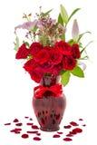 Roses rouges d'isolement sur le blanc Images stock