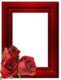 Roses rouges sur un cadre rouge pour des photos. Photos libres de droits