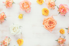 Roses on rustic wooden table Royalty Free Stock Photos