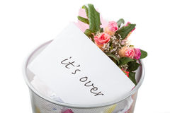 Roses and it's over note in dustbin. White isolated background Royalty Free Stock Photos
