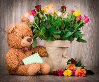 Roses in the sack and a teddy bear Royalty Free Stock Image