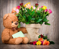Roses in the sack and a teddy bear Stock Images