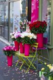 Roses for sale on the sidewalk. Urban setting flower shop with flower display on the sidewalk stock image