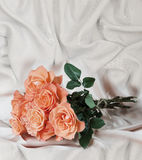 Roses on satin fabric Stock Photography