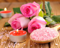 Roses, sea salt and candles Stock Photos