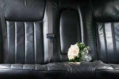 Roses at seat of newlywed limo Royalty Free Stock Photography