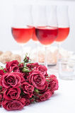 Roses and several glasses of rose wine Stock Photography