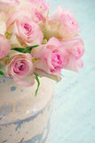 Roses in a shabby chic metal bucket Royalty Free Stock Photography