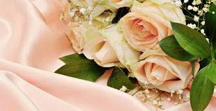 Roses on silk background Royalty Free Stock Photos