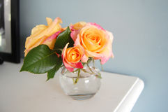 Roses in small vase. On mantel Stock Photo