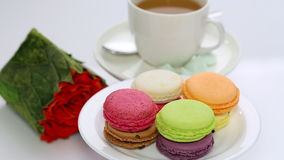 Roses and spinning macaron Stock Photography