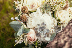 Roses, succulents and other flowers in wedding bouquet on green Royalty Free Stock Image