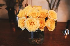 Roses on table in vase retro style royalty free stock photo