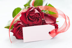 Roses with tag Royalty Free Stock Images
