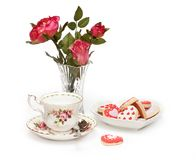 Roses, teacup, cookies Royalty Free Stock Image