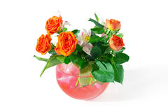 Roses and tiger lilies in a vase Royalty Free Stock Image