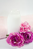 towel, bottle,silk roses Royalty Free Stock Image