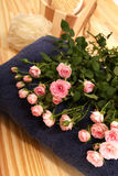 Roses, towels and spa accessories Royalty Free Stock Photos