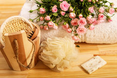 Roses, towels and spa accessories Stock Photo