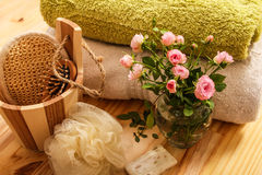 Roses, towels and spa accessories Stock Images