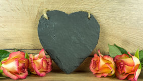 Roses in two colors with a heart of slate Stock Images