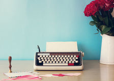 Roses and typewriter Stock Images
