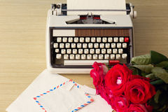 Roses and typewriter royalty free stock photos