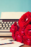 Roses and typewriter stock image