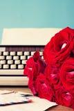 Roses and typewriter Stock Image