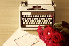 Roses and typewriter Royalty Free Stock Photography